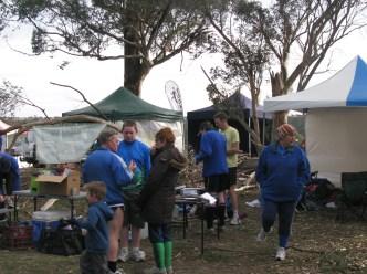 members-at-club-tent