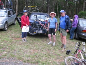 joyce-with-broken-bike-ron-and-helen